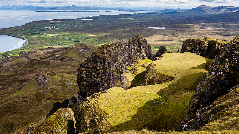 The Quiraing. The table is in the foreground. Staffin Bay lies away to top-left
